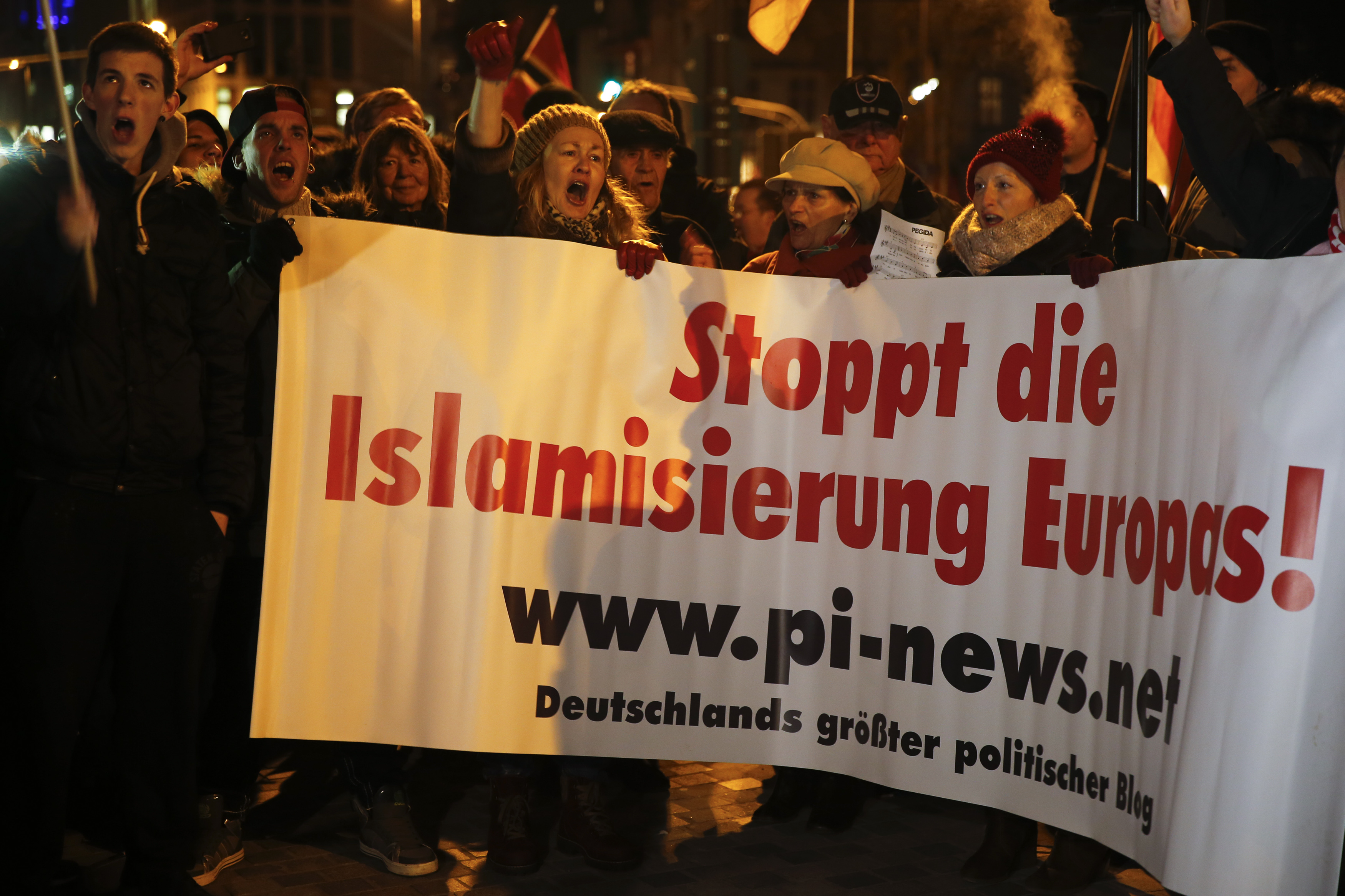 People take part in a march of a grass-roots anti-Muslim movement in Cologne